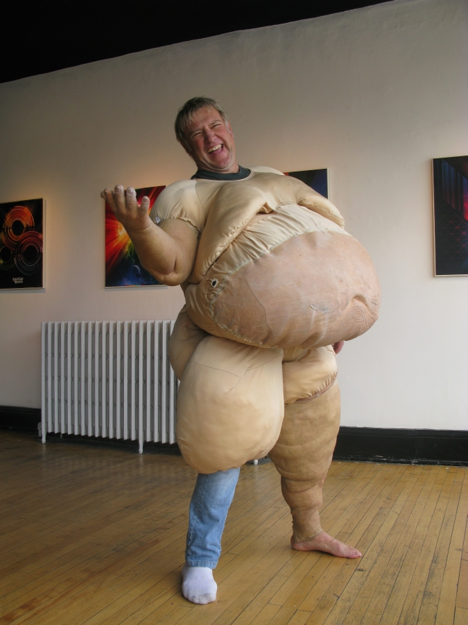 Alex Lifeson putting on the fat suit for the Time Machine Videos